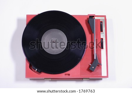 a record on an old red retro record player