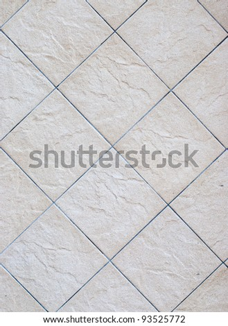 A rectangular pattern on the concrete floor