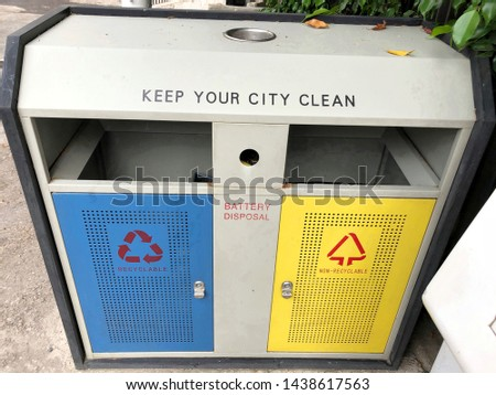 A recycle bin showing a place battery disposal and for recyclable and non-recyclable  #1438617563