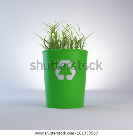 A recycling trash bin with growing grass