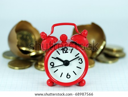A red alarm clock with a cracked golden investment egg cracked open revealing the Golden contents of coins in front it, signifying the longevity of the investment.
