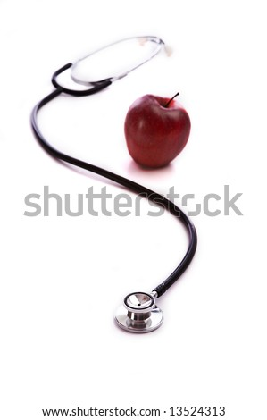 A red apple and a doctor or nurses stethoscope on a white background.  Health concept.  Medical ideas. - stock photo