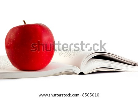 A red apple on a boo on white backgrond