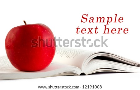 A red apple on a book and copy space for sample text here