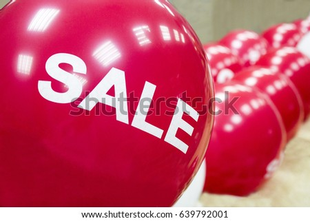 A red balloon with the inscription sale. Ball with inscription sale. #639792001