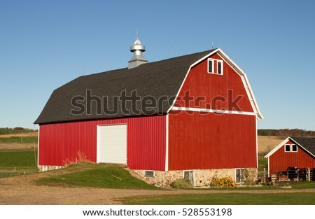 A red barn and horse shed on a Wisconsin farm in Autumn