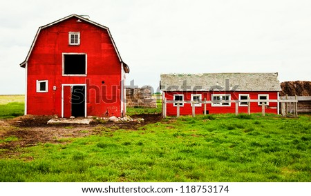 a red barn in the country.