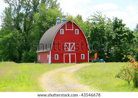 A red barn on a farm. - stock photo