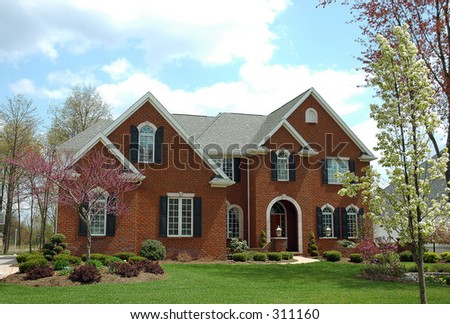 A red brick colonial style house.