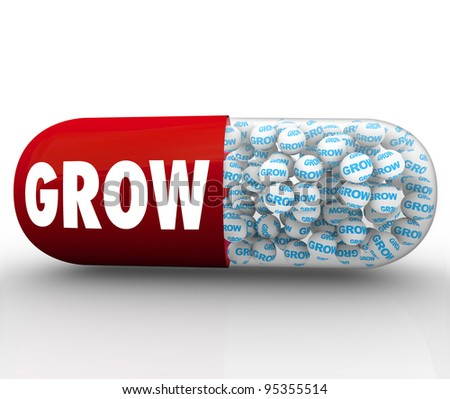 A red capsule pill with the word Grow to represent an instant solution to spur growth, change and improvement in a person or group with a goal to achieve