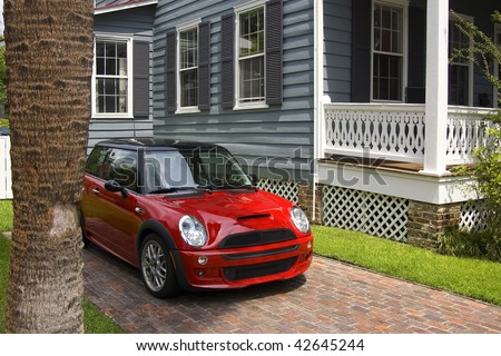A red car and a house
