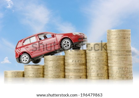 a red car climbing up a money chart isolated on a white background