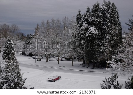 A red car in a winter scene