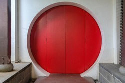 A Red Chinese circle door in China Town in Singapore.