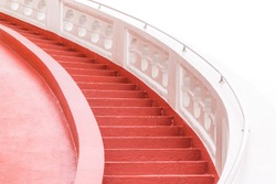 A red curved staircase for the top.