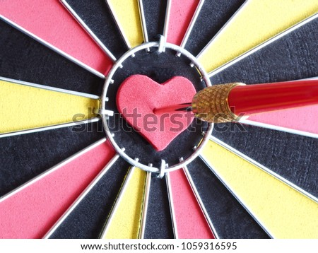 Shutterstock puzzlepix a red dart arrow hitting on heart shaped at bullseye of dartboard for reaching target and successful concept thecheapjerseys Gallery