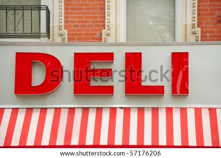 A red deli sign in the city. - stock photo