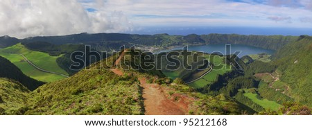 A red dirt path to a viewpoint over a landscape of Sete Cidades area showing several lagoons: Rasa, Santiago, Caldeira Seca, Caldeira do Alferes and Blue. Azores, San Miguel, Portugal