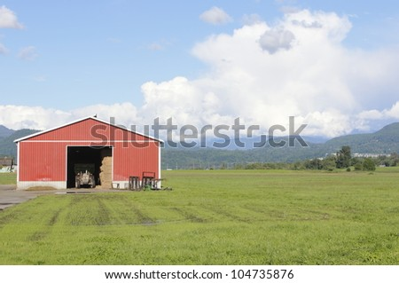 A red farm shed and tractor beside a field/Field and farm shed/Red Farm Shed and Field