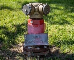 A red fire hydrant with sign.