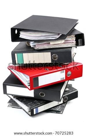A red foldeer in a tower of black ones.
