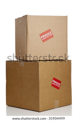 """A red """"Fragile"""" sticker on a brown box with copy space"""