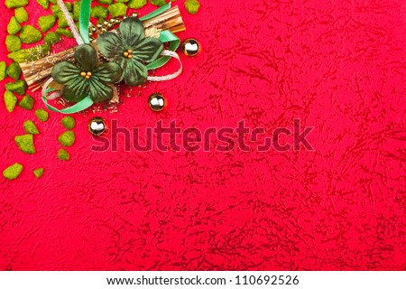 a red greeting card with green flowers