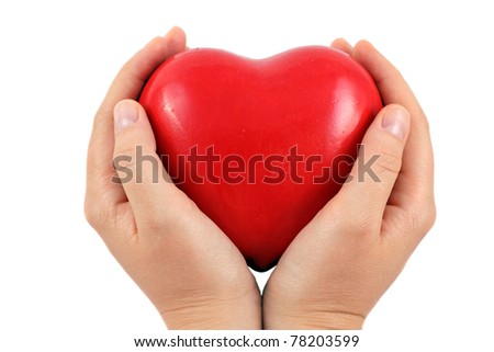 A Red heart in a hands, isolated on white