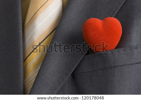 A red heart in a suit pocket representing the business card of modern Mr. Valentine.