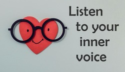 A red heart with glasses representing intuition