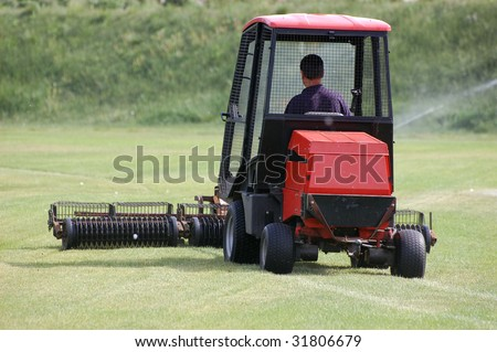 A red lawn mower.Golf club. Kiev,Ukraine.