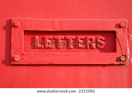 A red letter box cover.