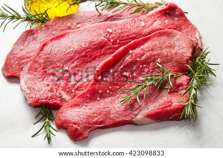 a red meat with rosemary on marble table #423098833