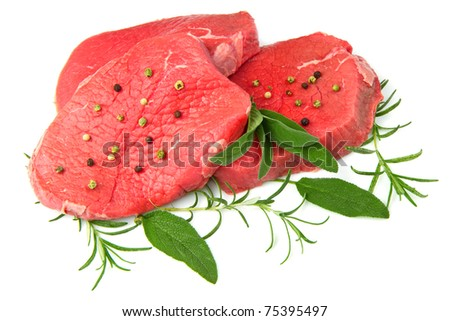 a red meat with sage and rosemary isolated on white background