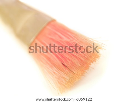 A red paint brush isolated on a white background