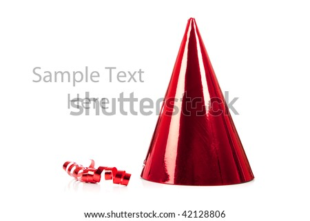 a red party hat and streamer on a white background with copy space