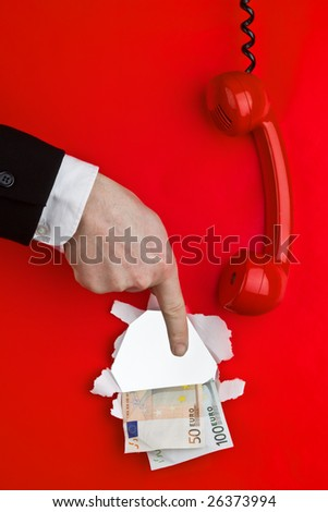 A red phone hanging off the hook with a hand pointing at money.