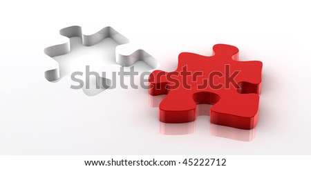 A red piece of a jigsaw puzzle fitting in the hole on the bottom