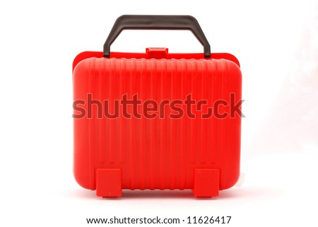 A red plastic suitcase for kids isolated on white background
