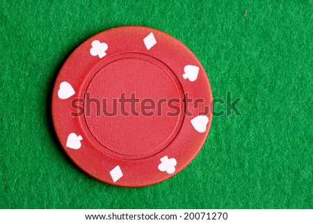 A red $5 poker chip