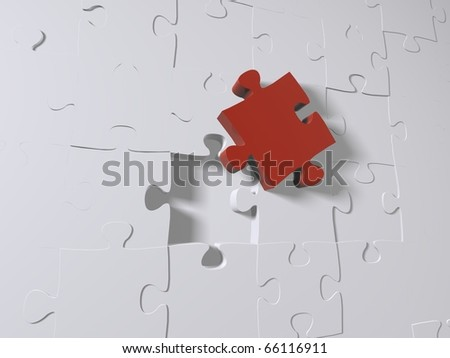 A red puzzle piece on grey pieces