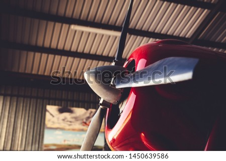 A red red vintage old engine airplane close up