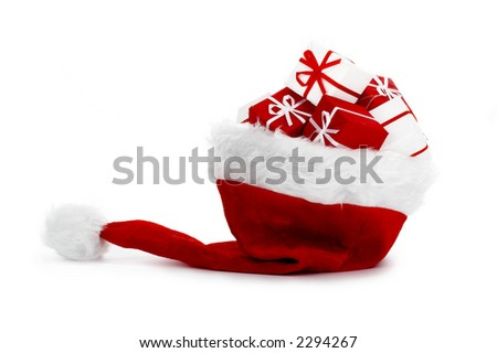A red santa hat with gifts isolated on white background