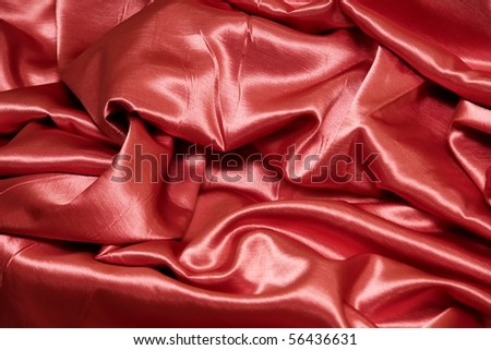 a red satin background