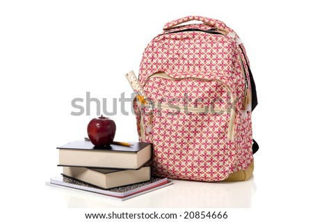 A red school back pack or book bag overflowing with school supplies including, notebooks, pens, pencils, rulers and glue