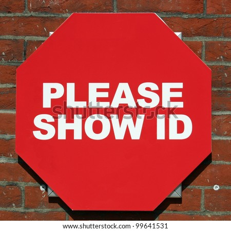 A red sign reading Please Show ID