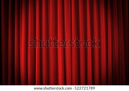 A red stage curtain with vignette light