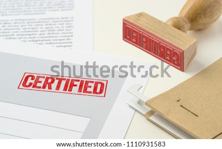 A red stamp on a document - Certified