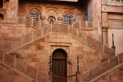 A red stone structure with twin staircases at Junagarh fort, Bikaner, Rajasthan, India, Asia