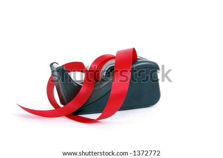 A red tape dispenser
